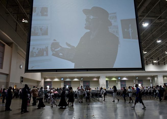 People leave the memorial service for D.C. Go-Go icon Chuck Brown Thursday, May 31, 2012 at the Washington Convention Center in Washington, D.C. (Barbara L. Salisbury/The Washington Times)