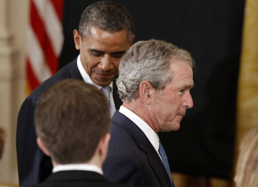 President Barack Obama and former President George W. Bush arrive in the East Room of the White House in Washington, Thursday, May 31, 2012, for Bush's portrait unveiling. (AP Photo/Charles Dharapak)