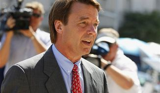 ** FILE ** John Edwards arrives at a federal courthouse during the eighth day of jury deliberations in his trial on charges of campaign corruption in Greensboro, N.C., Wednesday, May 30, 2012. (AP Photo/Chuck Burton)