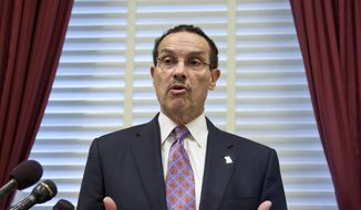 Washington, D.C. Mayor Vincent Gray speaks at a news conference on Capitol Hill, Tuesday, May 29, 2012, to object to actions by House Republicans whom he and Congresswoman Eleanor Holmes Norton say are targeting D.C.'s home-rule authority. (AP Photo/J. Scott Applewhite)