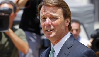 Former Sen. John Edwards leaves a federal courthouse in Greensboro, N.C., on Thursday, May 31, 2012, during the ninth day of jury deliberations in his trial on charges of campaign corruption. (AP Photo/Chuck Burton)