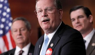 ** FILE ** Rep. Richard Nugent, Florida Republican, center, accompanied by Rep. Austin Scott, Georgia Republican, right, and Rep. Joe Wilson, South Carolina Republican, speaks during a news conference on Capitol Hill in Washington, Tuesday, Jan., 24, 2012, to discuss the budget. (AP Photo/Pablo Martinez Monsivais)