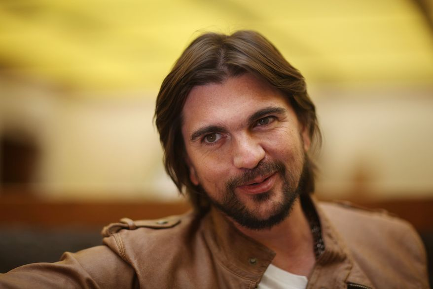 "** FILE ** In this May 4, 2012, file photo, Colombia's singer Juanes poses for photos during an interview to promote his new album ""Juanes MTV Unplugged,"" in Mexico City. (AP Photo/Alexandre Meneghini, file)"