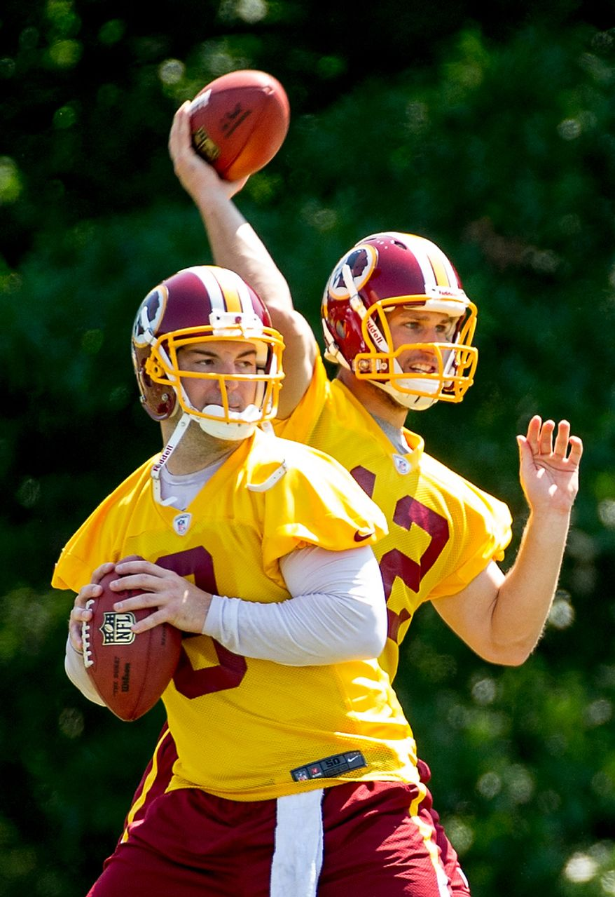 Washington Redskins quarterbacks Rex Grossman (8), left, and Kirk Cousins , right, throw during offensive drills during an organized team activity at Redskins Park, Ashburn, Va., Thursday, May 31, 2012. (Andrew Harnik/The Washington Times)