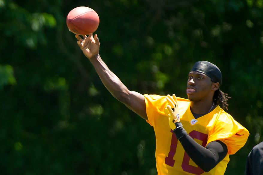 Washington Redskins quarterback Robert Griffin III (10) throws during offensive drills at an organized team activity at Redskins Park, Ashburn, Va., Thursday, May 31, 2012. (Andrew Harnik/The Washington Times)