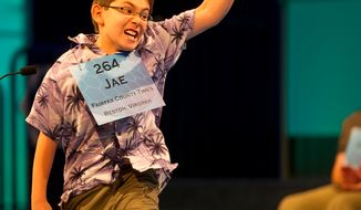 Jae Canetti, 10, of Fairfax, Va., celebrates after spelling his word correctly during the semifinals of the 2012 Scripps National Spelling Bee at the Gaylord National Resort and Convention Center in National Harbor, Md., Thursday, May 31, 2012. (Rod Lamkey Jr./The Washington Times)