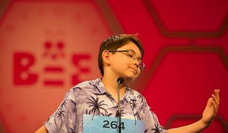 Jae Canetti, 10, of Fairfax, Va., reacts after misspelling his word and being eliminated from the semifinals of the 2012 Scripps National Spelling Bee at the Gaylord National Resort and Convention Center in Oxon Hill, Md., Thursday, May 31, 2012. (Rod Lamkey Jr/The Washington Times)