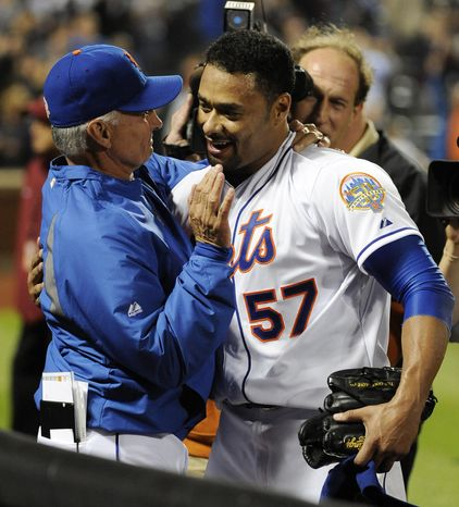 New York Mets starting pitcher Johan Santana hugs manager Terry Collins after he threw a no-hitter against the St. Louis Cardinals on Friday, June 1, 2012, at Citi Field in New York. The Mets won 8-0. (AP Photo/Kathy Kmonicek)