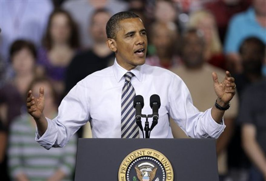 President Obama speaks on Friday, June 1, 2012, at Honeywell Automation and Control Solutions' global headquarters in Golden Valley, Minn., about jobs for veterans. (Associated Press)