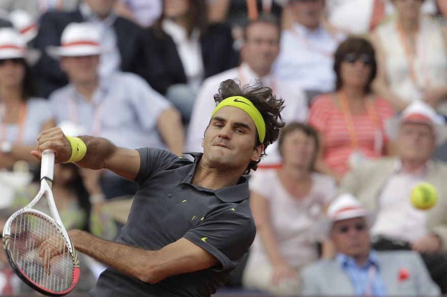 Roger Federer defeated Nicolas Mahut the French Open in Roland Garros stadium in Paris on Friday June 1, 2012. (AP Photo/Michel Spingler)