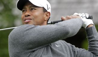 Tiger Woods watches his tee shot on the second hole during the second round of the Memorial golf tournament Friday, June 1, 2012, in Dublin, Ohio. (AP Photo/Jay LaPrete)