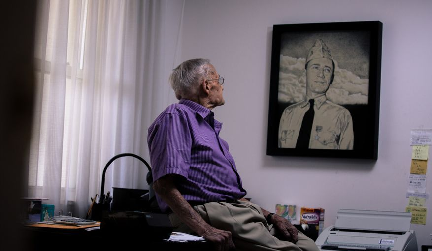 "Retired Rear Adm. Donald ""Mac"" Showers, 92, sits in his office as he stares at a portrait of himself from the 1940s at his home in Arlington, Va., on May 3, 2012. Showers is one of the remaining survivors that helped lead the effort to break the Japanese code which resulted in a victory at battle of Midway. (Andrew S. Geraci/The Washington Times)"