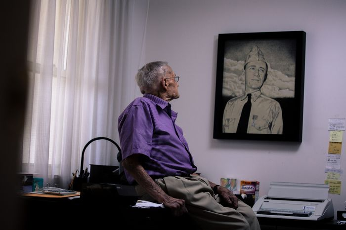 """Retired Rear Adm. Donald """"Mac"""" Showers, 92, sits in his office as he stares at a portrait of himself from the 1940s at his home in Arlington, Va., on May 3, 2012. Showers is one of the remaining survivors that helped lead the effort to break the Japanese code which resulted in a victory at battle of Midway. (Andrew S. Geraci/The Washington Times)"""