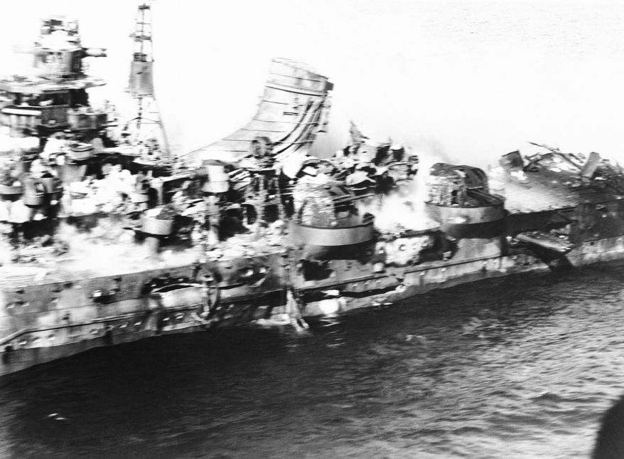 Flying dangerously close, a U.S. Navy photographer got this spectacular aerial view of a heavy Japanese cruiser of the Mogima class, demolished by Navy bombs, in the battle off Midway on June 21, 1942.  Armor plate, steel decks and superstructure are a tumbled mass. The Navy damaged or sank 17 enemy vessels in the historic engagement. (Associated Press)