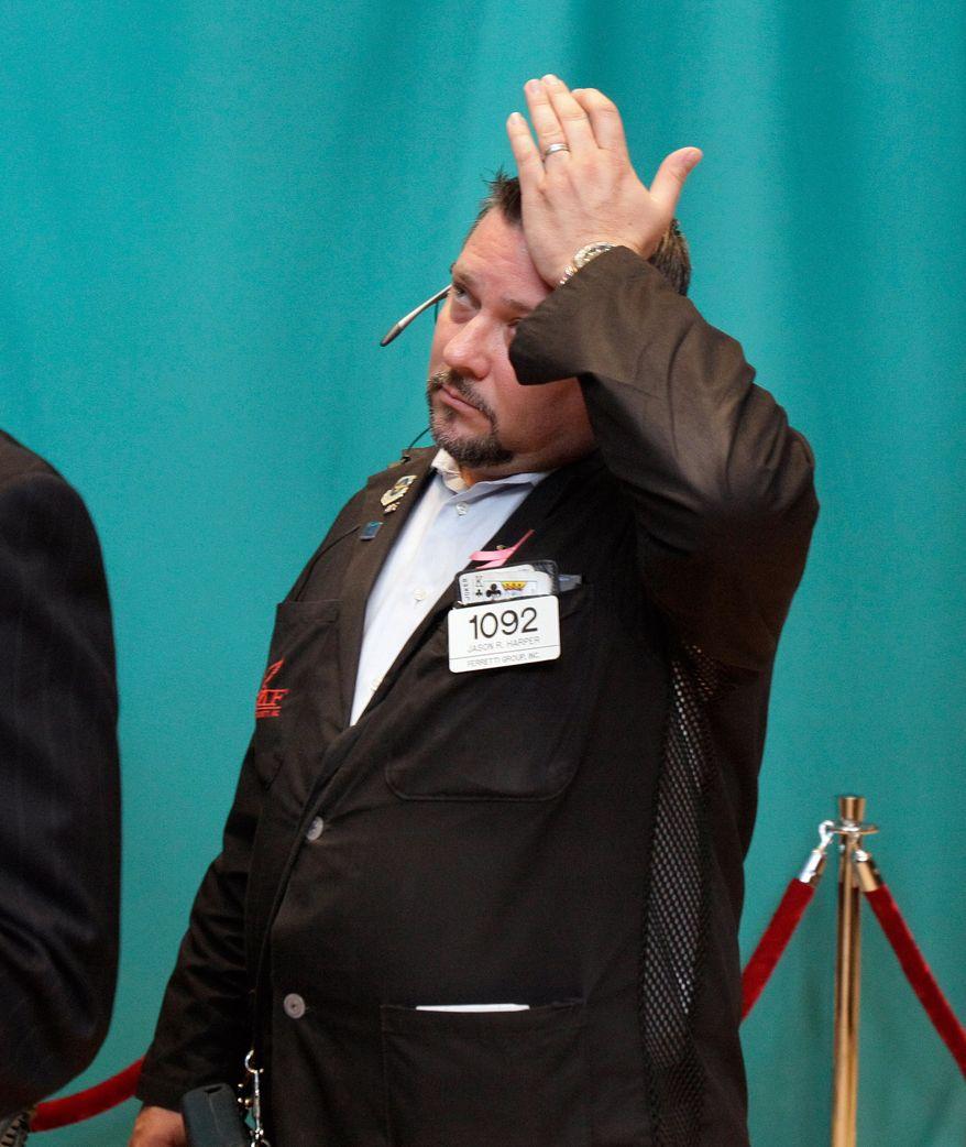 Trader Jason Harper works June 1, 2012, on the floor of the New York Stock Exchange. (Associated Press)
