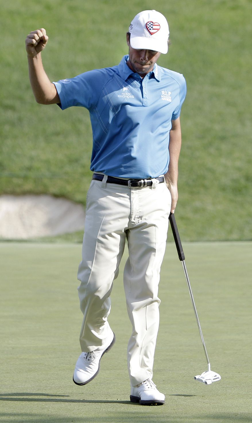 Spencer Levin reacts to making a putt on the 17th hole during the third round of the Memorial tournament Saturday, June 2, 2012, in Dublin, Ohio. (AP Photo/Jay LaPrete)