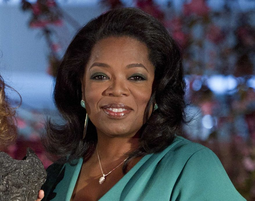 """** FILE ** This March 9, 2012, file photo shows Oprah Winfrey at the Third Annual DVF Awards held at the United Nations. Winfrey's OWN cable channel and her magazine are bringing back her book club, starting with the memoir """"Wild"""" by Cheryl Strayed. (AP Photo/Charles Sykes, file)"""