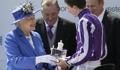 Britain's Queen Elizabeth II presents the trophy to the winning jockey of the Diamond Jubilee Coronation Cup race Joseph O'Brien who rode St Nicholas Abbey during the Epsom Derby at Epsom race course, southern England at the start of a four-day Diamond Jubilee celebration to mark the 60th anniversary of the Queen's accession to the throne, Saturday, June 2, 2012. (AP Photo/Sang Tan)
