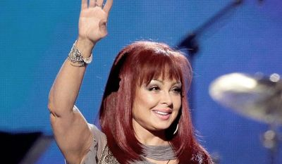 "** FILE ** In this April 4, 2011 photo, country singer Naomi Judd performs at the Girls' Night Out: Superstar Women of Country in Las Vegas. Judd is hosting a limited-run talk show on SiriusXM called ""Think Twice."" Her first guest will be Ashley Judd, June 8. (AP Photo/Julie Jacobson, file)"
