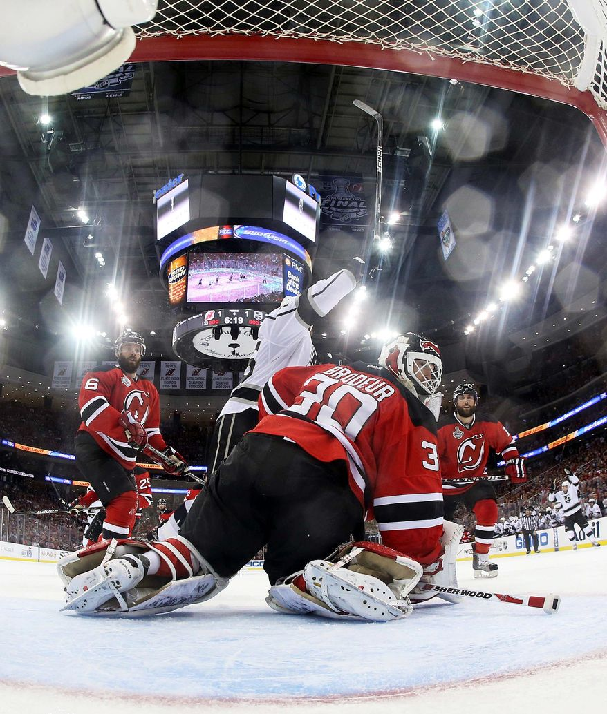 New Jersey goalie Martin Brodeur looks away after allowing Jeff Carter's overtime goal Saturday. Carter's fifth postseason goal gave the Kings a 2-1 win and a 2-0 lead in the Stanley Cup Final as the series shifts to Los Angeles. (Associated Press)