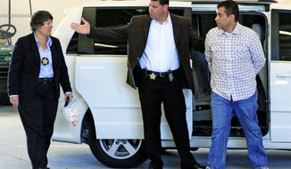 After his bond was revoked, George Zimmerman (right) returns to the John E. Polk Correctional Facility in Sanford, Fla., on Sunday. Mr. Zimmerman is charged with second-degree murder in the shooting of Trayvon Martin. Mr. Zimmerman's lawyers will ask for a new bond hearing. (Associated Press)