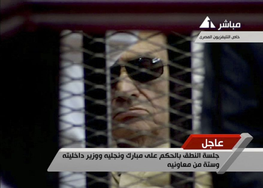 Former Egyptian President Hosni Mubarak is seen in the defendant's cage as a judge reads the verdict on charges of complicity in the killing of protesters during last year's uprising that forced him from power, in Cairo on Saturday, June 2, 2012. (AP Photo/Egyptian State TV)