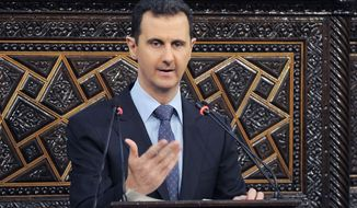 Syrian President Bashar Assad speaks to parliament in Damascus, Syria, on Sunday, June 3, 2012. (AP Photo/SANA)