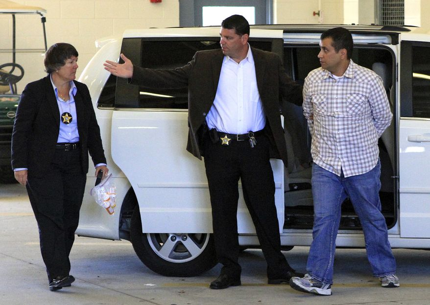 George Zimmerman (right) returns to the John E. Polk Correctional Facility in Sanford, Fla., on Sunday, June 3, 2012, after his bond was revoked. Mr. Zimmerman is charged with second-degree murder in the shooting of Trayvon Martin. (AP Photo/Orlando Sentinel, Joshua C. Cruey, Pool)