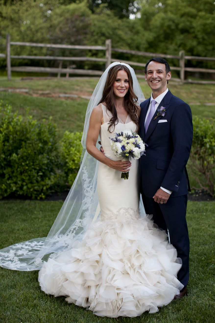 Ashley Biden, daughter of Vice President Joe Biden and Jill Biden, and her new husband, Dr. Howard Krein, pose for a portrait at their wedding in Wilmington, Del., on Saturday, June 2, 2012. (AP Photo/The White House, David Lienemann)