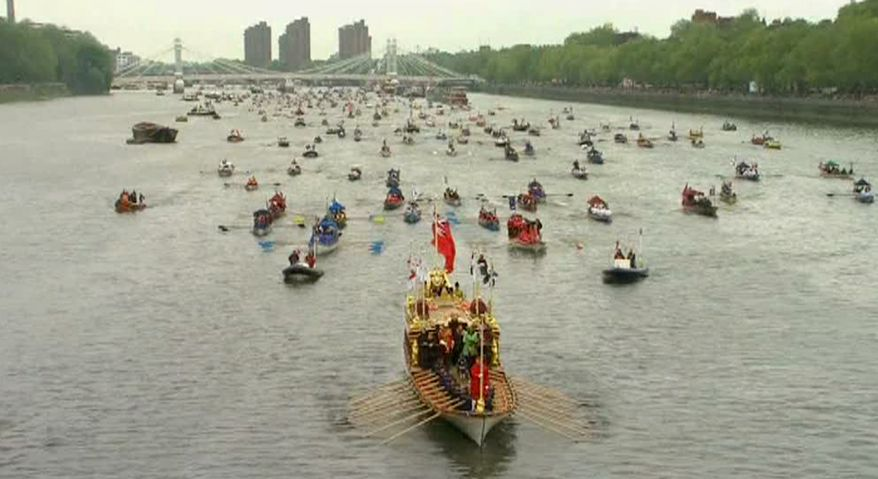 The Gloriana leads part of the flotilla of 1,000 vessels on the River Thames in London on Sunday, June 3, 2012, during a river pageant to celebrate Queen Elizabeth's Diamond Jubilee. (AP Photo/SKY TV via APTN)