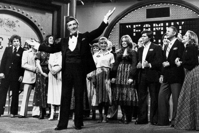 "Richard Dawson (foreground) hosts the TV game show ""Family Feud"" in May 1978 as the casts of ABC comedy series ""Eight Is Enough,"" ""The Love Boat,"" ""Soap"" and ""Three's Company"" compete to benefit charity. (Associated Press)"