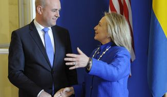 Swedish Prime Minister Fredrik Reinfeldt (left) greets U.S. Secretary of State Hillary Rodham Clinton as she arrives for meetings at Rosenbad in Stockholm on Sunday, June 3, 2012. (AP Photo/Erik Martensson)