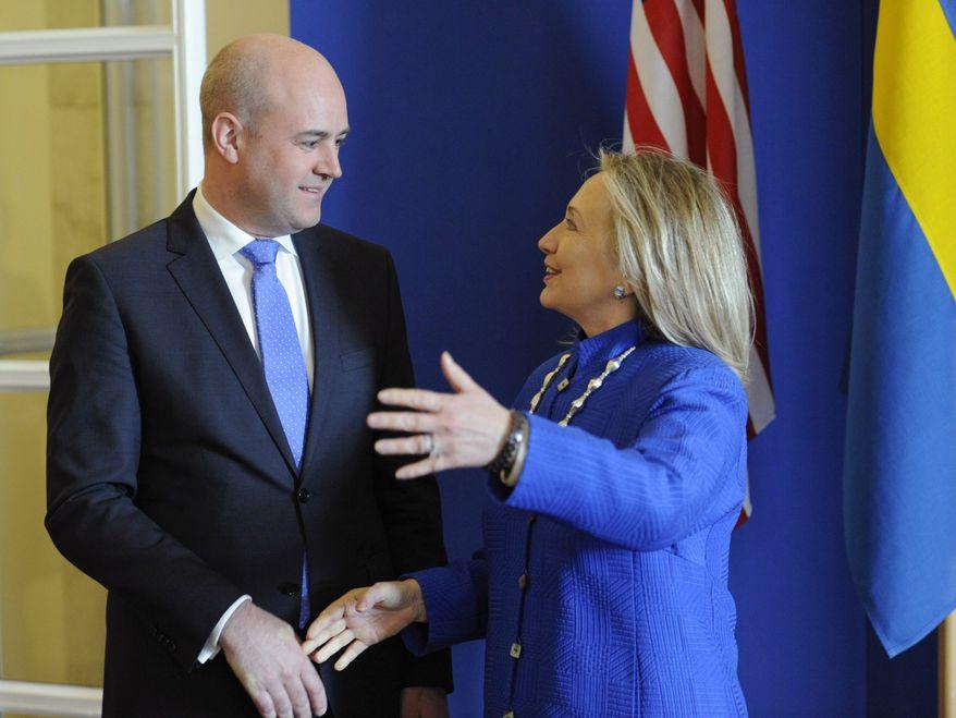 Swedish Prime Minister Fredrik Reinfeldt (left) greets U.S. Secretary of State Hillary Rodham Clinton as she arrives for meetings at Rosenbad in Stockholm on Sunday, June 3, 2012. (AP Photo/Erik Martensson)