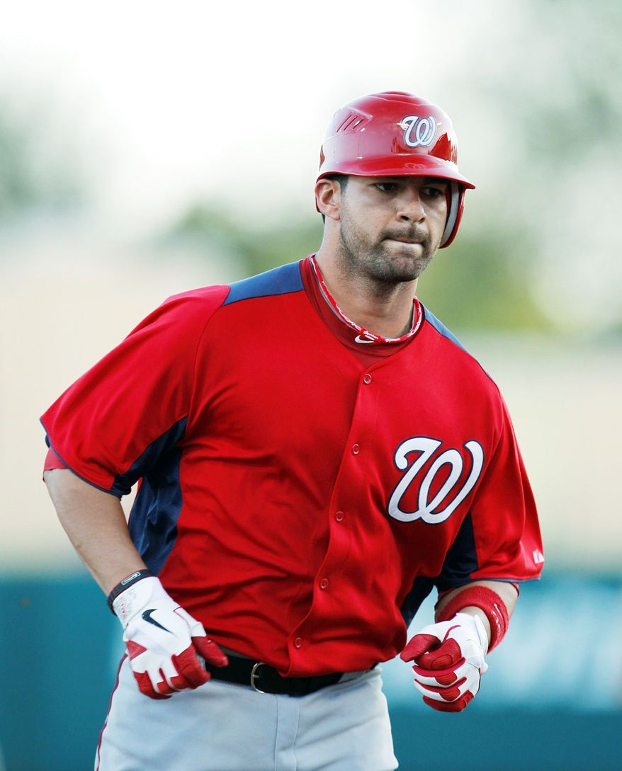 Washington Nationals Jesus Flores rounds the bases after hitting a solo home run against the Atlanta Braves in the fourth inning of a spring training baseball game in Kissimmee, Fla., Wednesday, March 14, 2012. (AP Photo/Paul Sancya)
