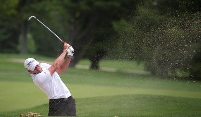 Michael Tobiason, Jr., of Wilmington, Del., takes a shot from the sand trap on the first fairway during the U.S. Open qualifier at the Woodmont Country Club in Rockville, Md., Monday, June 4, 2012. (Rod Lamkey Jr/The Washington Times)