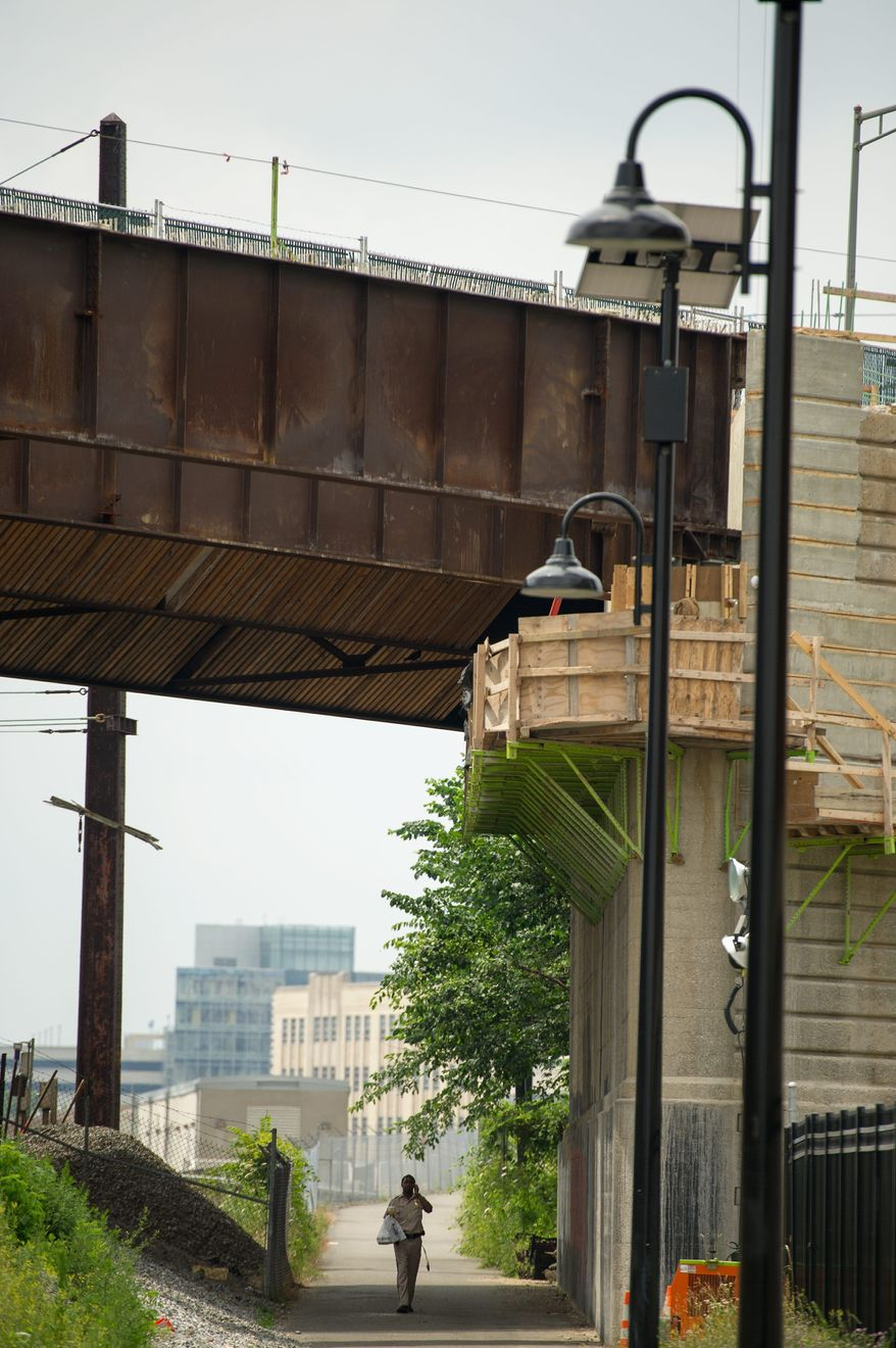 Phase one of the New York Avenue Bridge project is nearing completion. Heavy train traffic under the bridge has limited the time workers are given to safely do reconstruction near the tracks. (Andrew Harnik/The Washington Times)