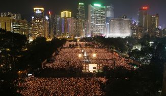 Tens of thousands of people attend a candlelight vigil at Hong Kong's Victoria Park on June 4, 2012, to mark the 23rd anniversary of the Chinese military crackdown on the pro-democracy movement in Beijing. (Associated Press)