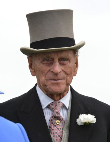 Britain's Prince Philip views the horses from the parade ring before the Diamond Jubilee Coronation Cup race at Epsom Derby in Epsom, England, on Saturday, June 2, 2012, the first official day of the Queen's Diamond Jubilee celebrations. (Associated Press)