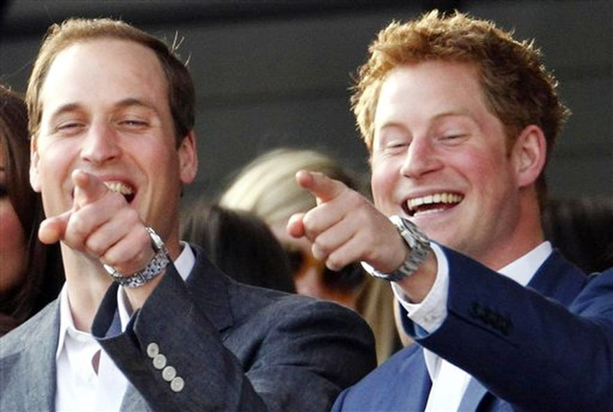 The Duke of Cambridge with his brother Prince Harry, right, pointing at something as they attend the Diamond Jubilee concert in London.  (AP Photo / Dave Thompson, Pool)