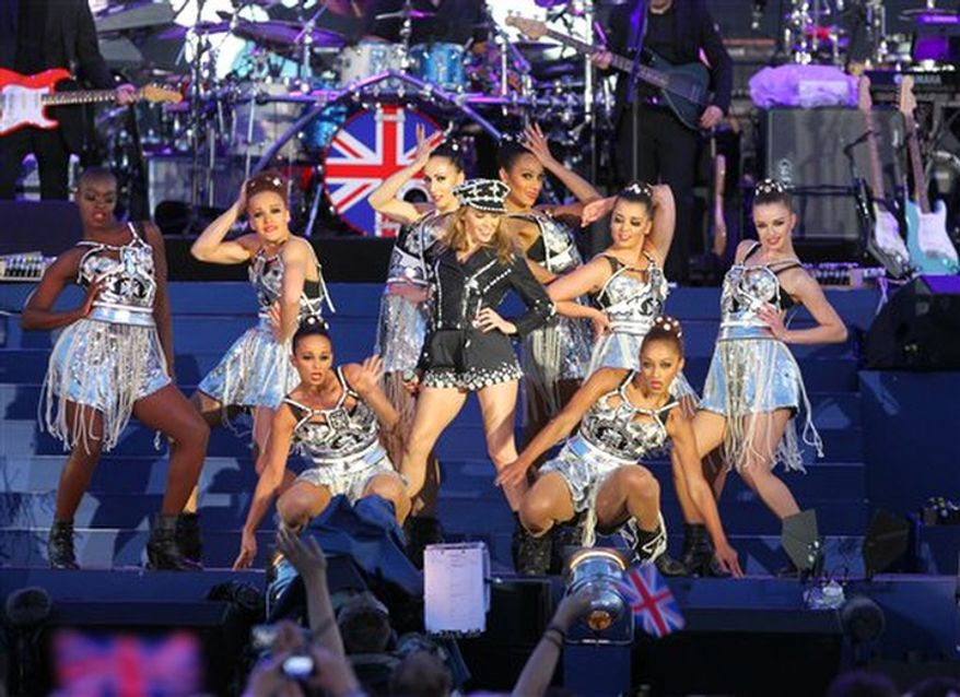 Kylie Minogue, centre, performs at the Queen's Jubilee Concert in front of Buckingham Palace. (AP Photo/Joel Ryan)