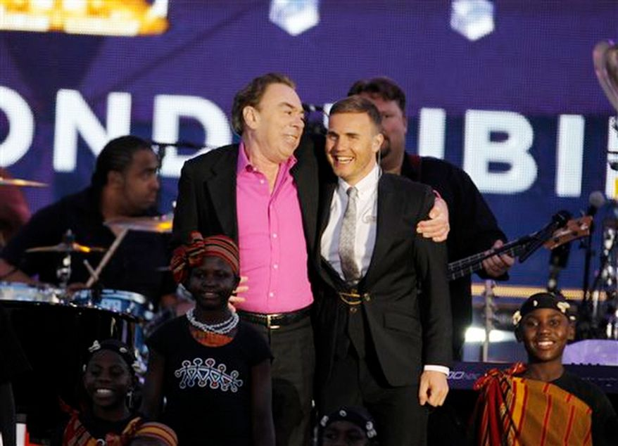 Sir Andrew Lloyd Webber and Gary Barlow onstage at the Queen's Jubilee Concert in front of Buckingham Palace, London. (AP Photo/Joel Ryan)