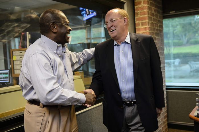 Former Republican presidential candidate Herman Cain shakes hands June 4, 2012, with news talk radio host Neal Boortz after he was announced as Boortz's successor upon Boortz's retirement announcement during his morning show at Atlanta's WSB radio. Cain will replace Boortz full-time following inauguration day, Jan. 21, 2013. (Associated Press)