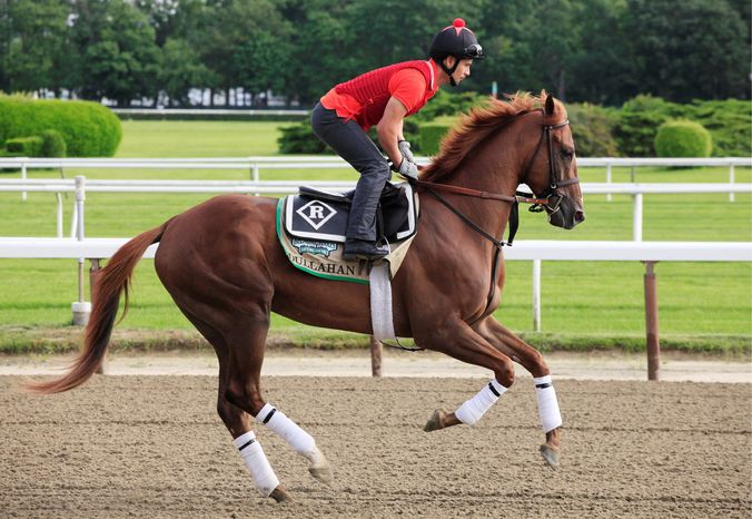Dullahan, with exercise rider Faustino Aguilar up, works on the track at Belmont Park in Elmont, N.Y., Tuesday, June 5, 2012. Dullahan is entered in Saturday's Belmont Stakes horse race. (AP Photo/Mark Lennihan)