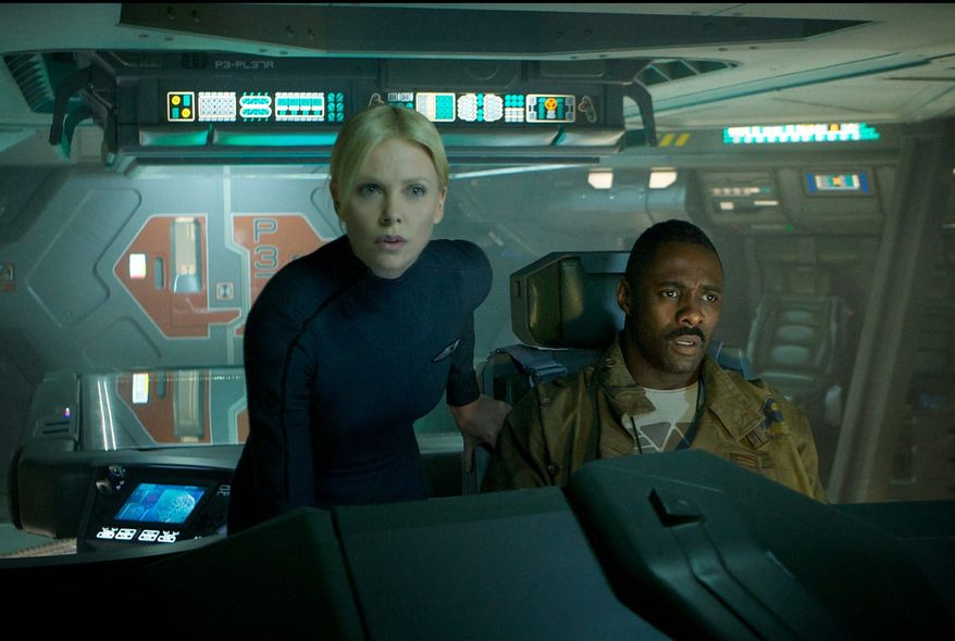 "Charlize Theron and Idris Elba star as space explorers in ""Prometheus,"" a mysterious thriller that provides some loose back story to the 1979 science-fiction classic ""Alien."" (20th Century Fox via Associated Press)"