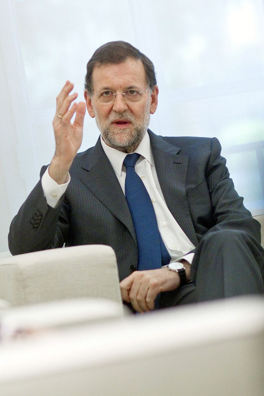 "Spanish Prime Minister Mariano Rajoy told a Spanish Senate session Tuesday that Europe ""needs to support those that are in difficulty."" (Associated Press)"
