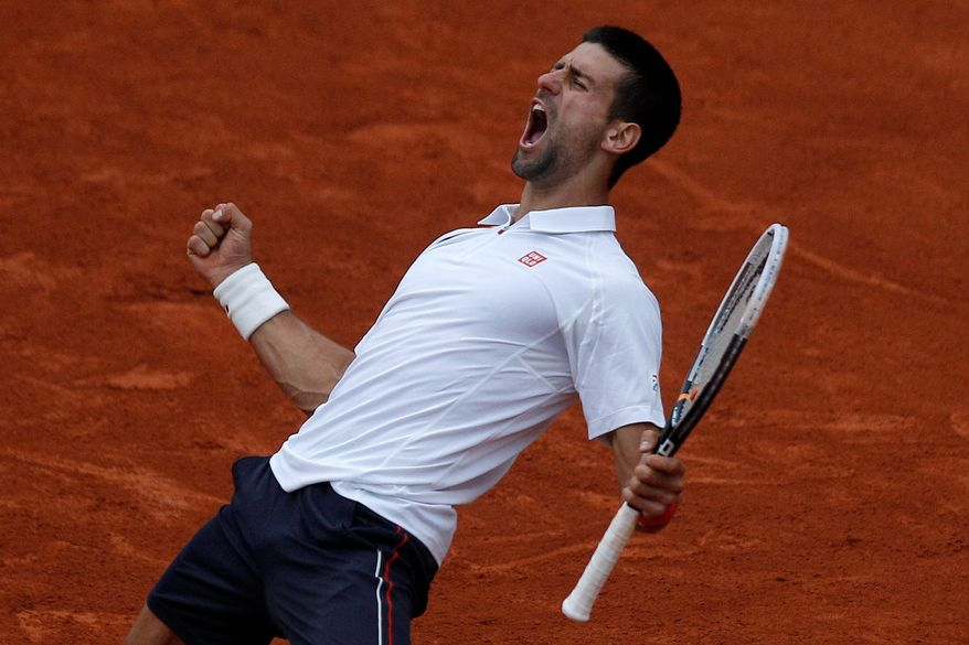 Novak Djokovic turned back fifth-seeded - and crowd favorite - Jo-Wilfried Tsonga in five sets to win his 26th consecutive Grand Slam match. He'll face 16-time major champion Roger Federer in the French Open semifinals. (Associated Press)