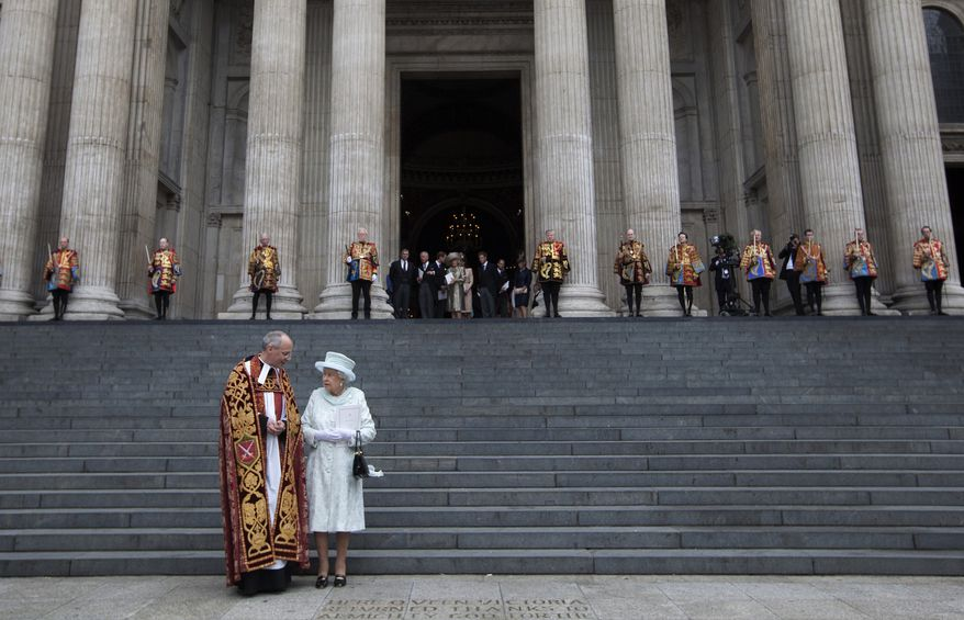 Britain's Queen Elizabeth II and the Very Rev. David Ison, dean of St. Paul's Cathedral, look at a commemorative inscription to Queen Victoria, Britain's only other monarch to reign for 60 years, outside the cathedral in London following a national service of thanksgiving for the monarch on Tuesday, June 5, 2012. (AP Photo/Alastair Grant)