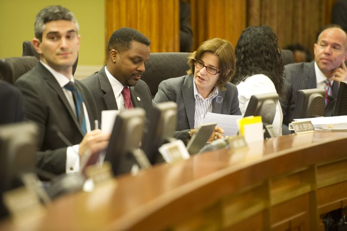 D.C. Council Chairman Kwame R. Brown (second from left) chats with council member Mary Cheh, Ward 3 Democrat, as other lawmakers arrive for a meeting at the John A. Wilson Building in Washington on Tuesday, June 5, 2012, to discuss and vote on the fiscal 2013 budget. (Rod Lamkey Jr./The Washington Times)