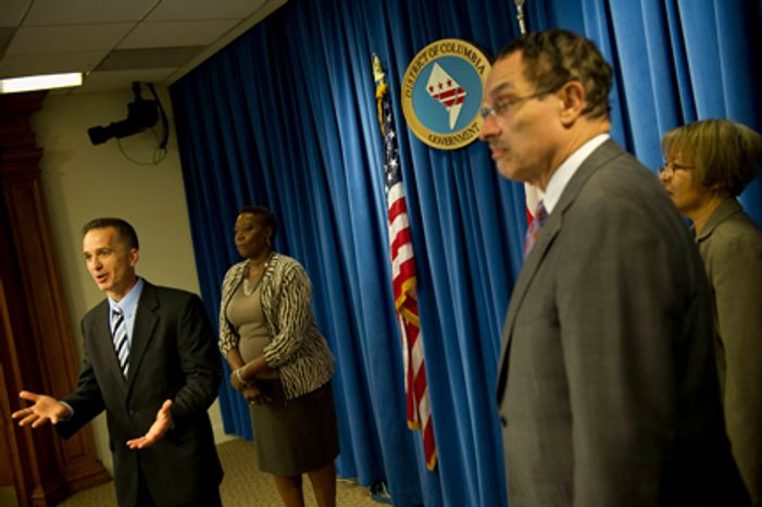 D.C. Mayor Vincent C. Gray (second from right) holds a press conference to announce his nominees to the new Board of Ethics and Government Accountability Robert J. Spagnoletti (left) Deborah A. Lathen (second from left) and Laura M. Richards (right) at the John A. WIlson Building on Tuesday, June 5, 2012. (Rod Lamkey Jr/The Washington Times)