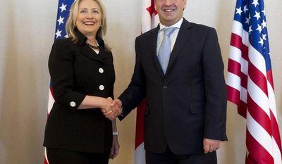 Georgian Prime Minister Nika Gilauri (right) greets U.S. Secretary of State Hillary Rodham Clinton before their meeting in Batumi, Georgia, on Tuesday, June 5, 2012. (AP Photo/Saul Loeb, Pool)